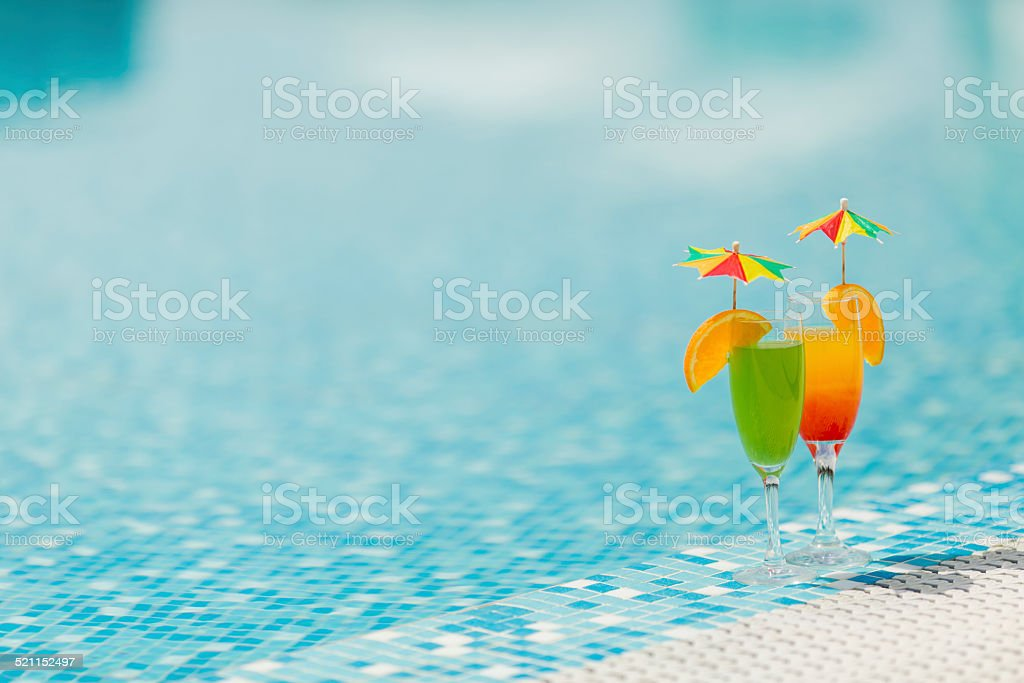 Cocktails by the pool stock photo