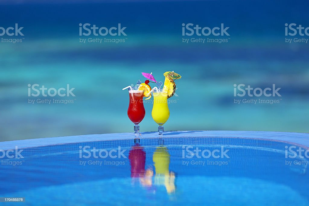 cocktails by the poolside stock photo