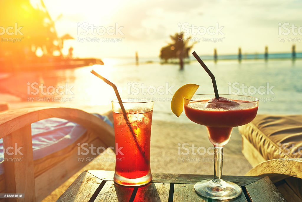 Cocktails near swimming pool stock photo