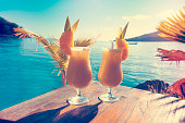 Cocktails on a table with ocean background