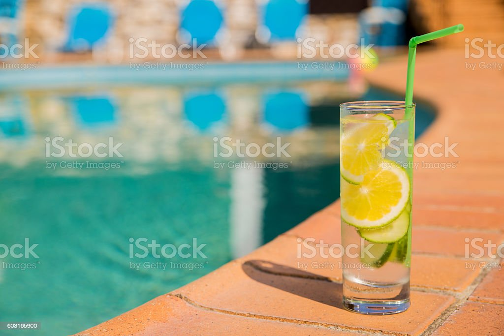 Cocktails on summer on edge of swimming pool stock photo
