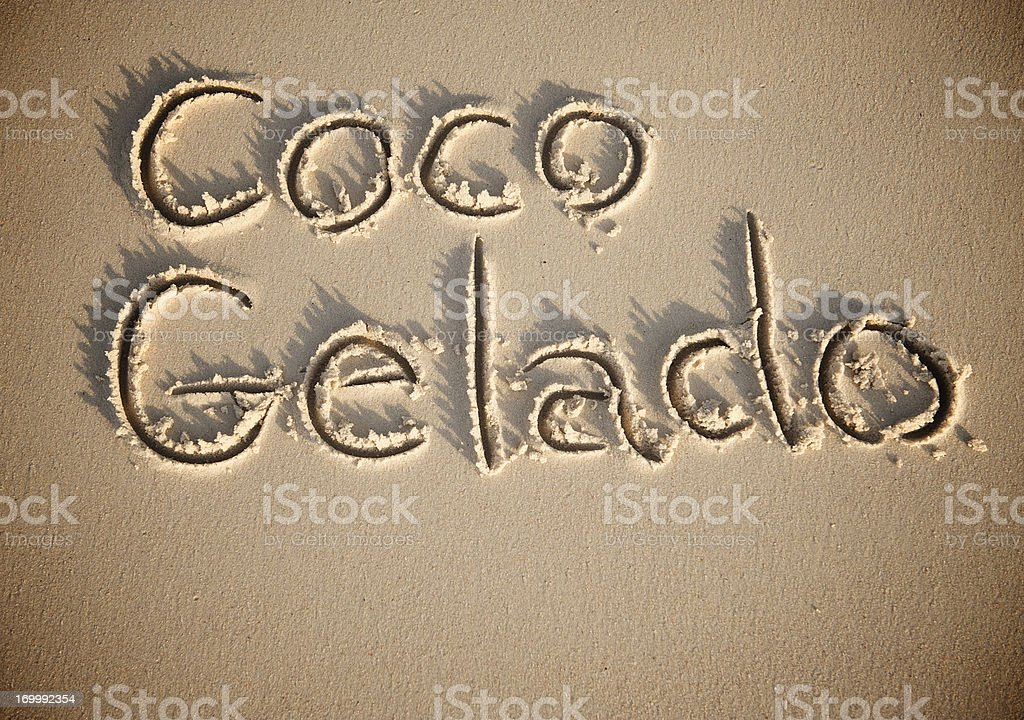 Coco Gelado Chilled Brazilian Coconut Message in Sand stock photo