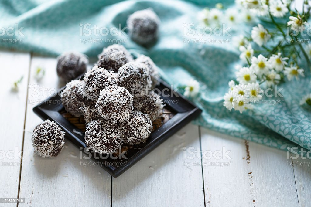 Cocoa and coconut energy balls stock photo