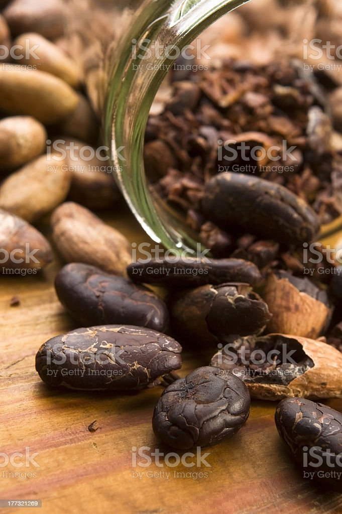 Cocoa ( cacao ) beans on natural wooden table royalty-free stock photo