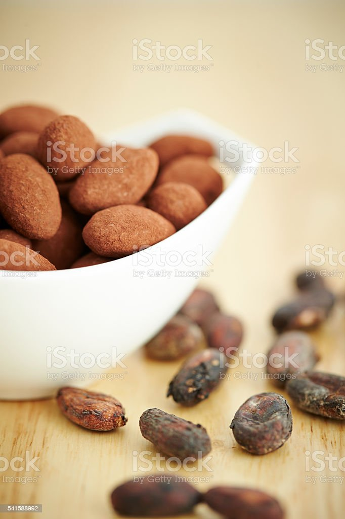 Cocoa dusted almonds stock photo