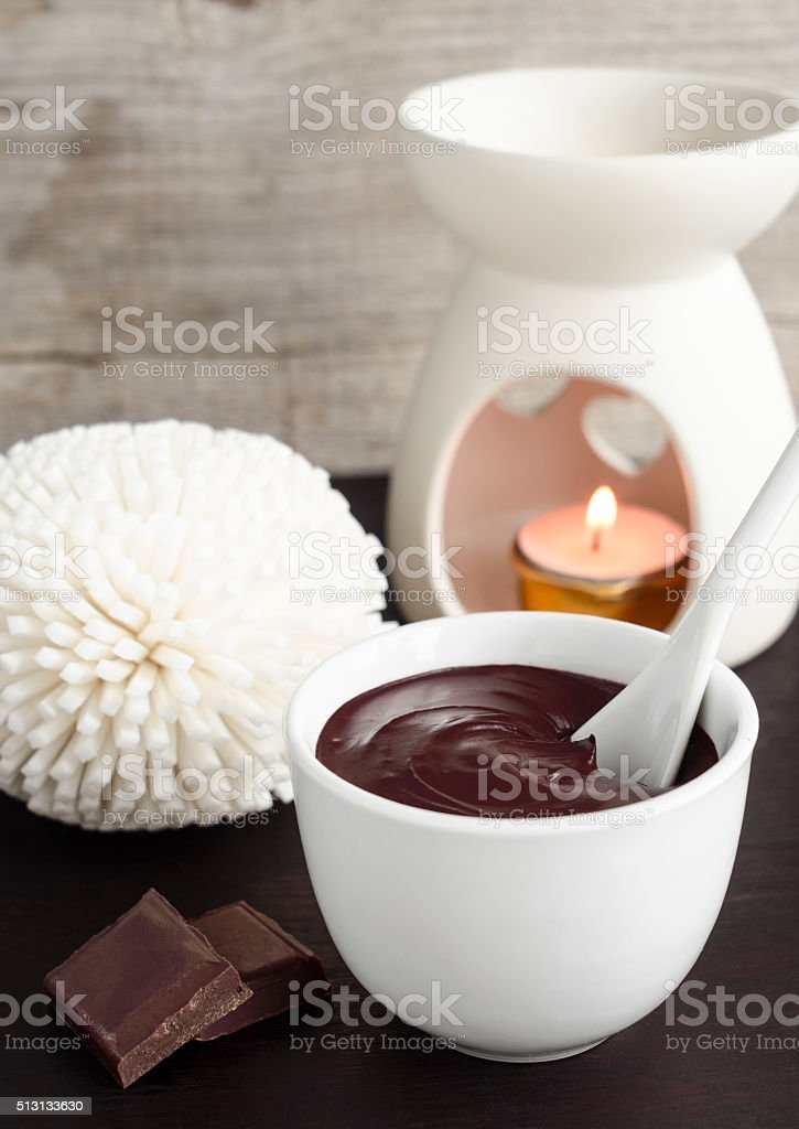 Cocoa (dark chocolate) face and body mask in a bowl stock photo
