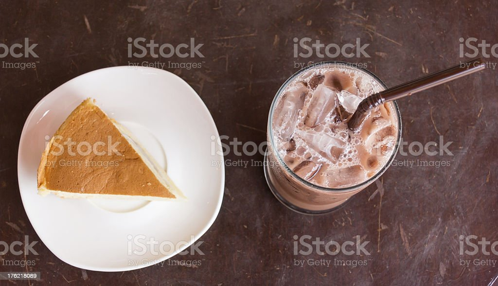 Cocoa ice and cake on wood table royalty-free stock photo