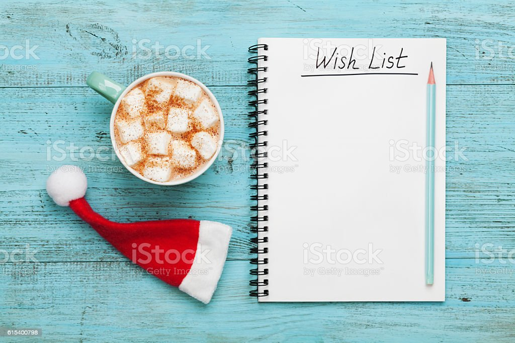 Cocoa or chocolate, Santa Claus hat and notebook, christmas planning. stock photo