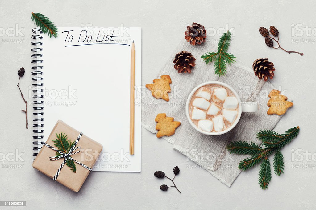 Cocoa or chocolate with christmas decorations and to do list. stock photo