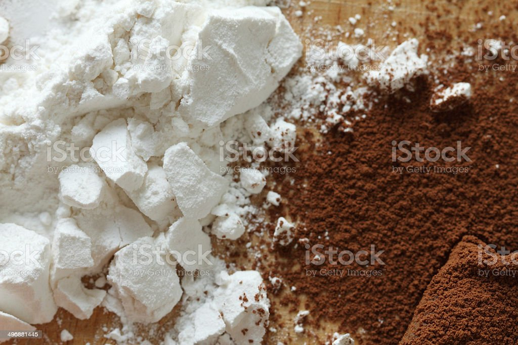 Cocoa powder and flour on plate stock photo