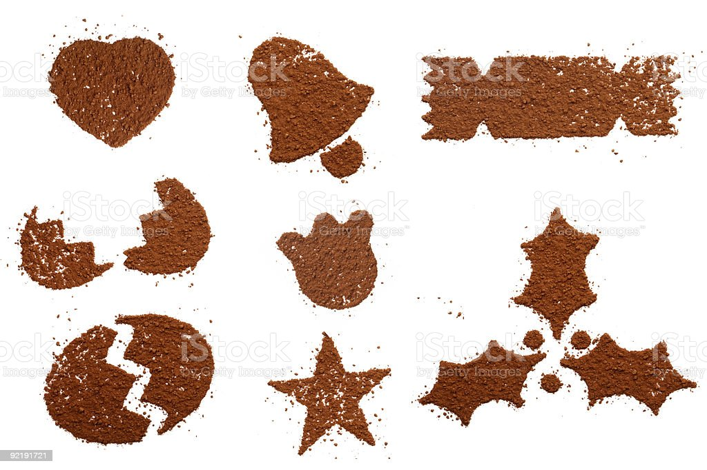 Cocoa powder dust in festive symbol shapes stock photo