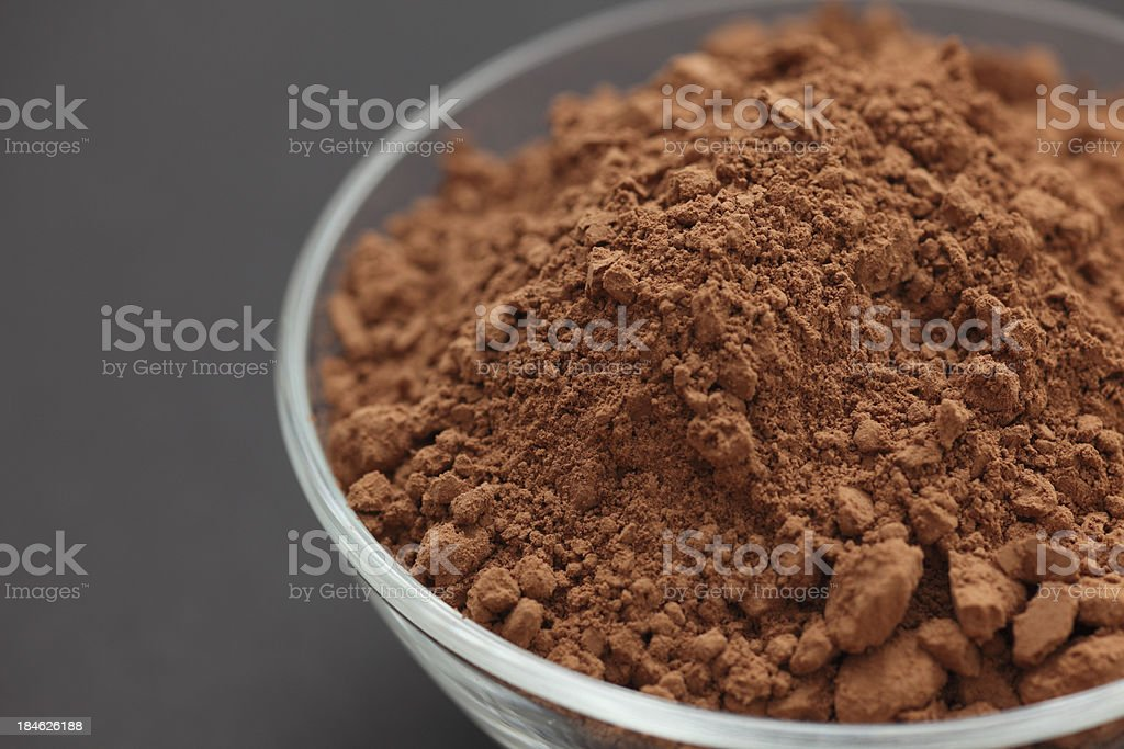 Cocoa powder in a glass bowl stock photo