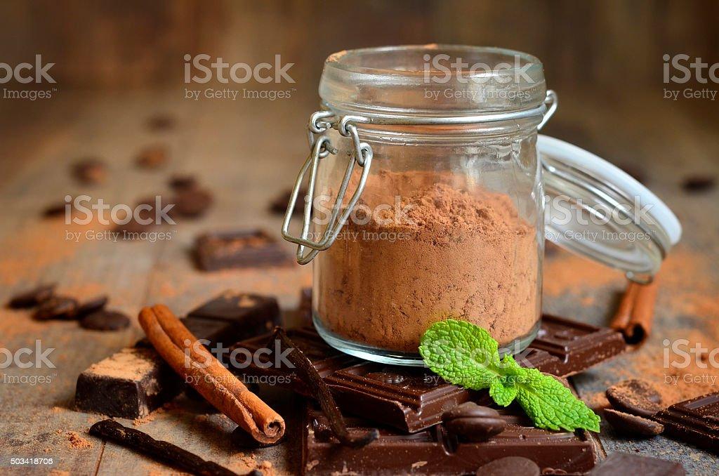 Cocoa powder in a glass jar. stock photo