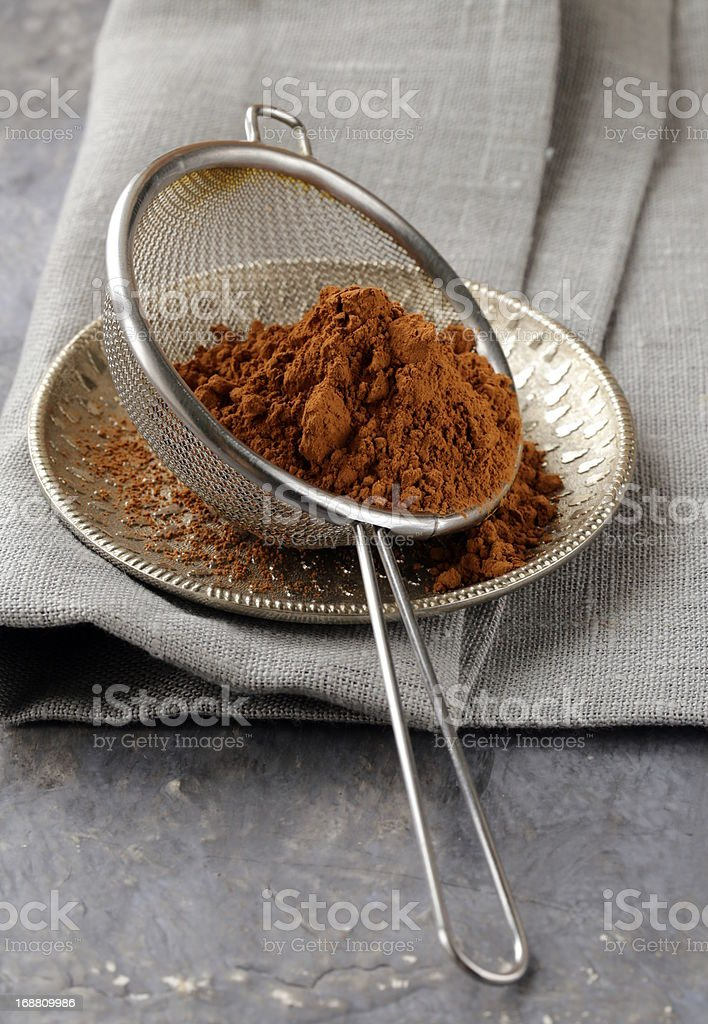 cocoa powder in a metal sieve royalty-free stock photo