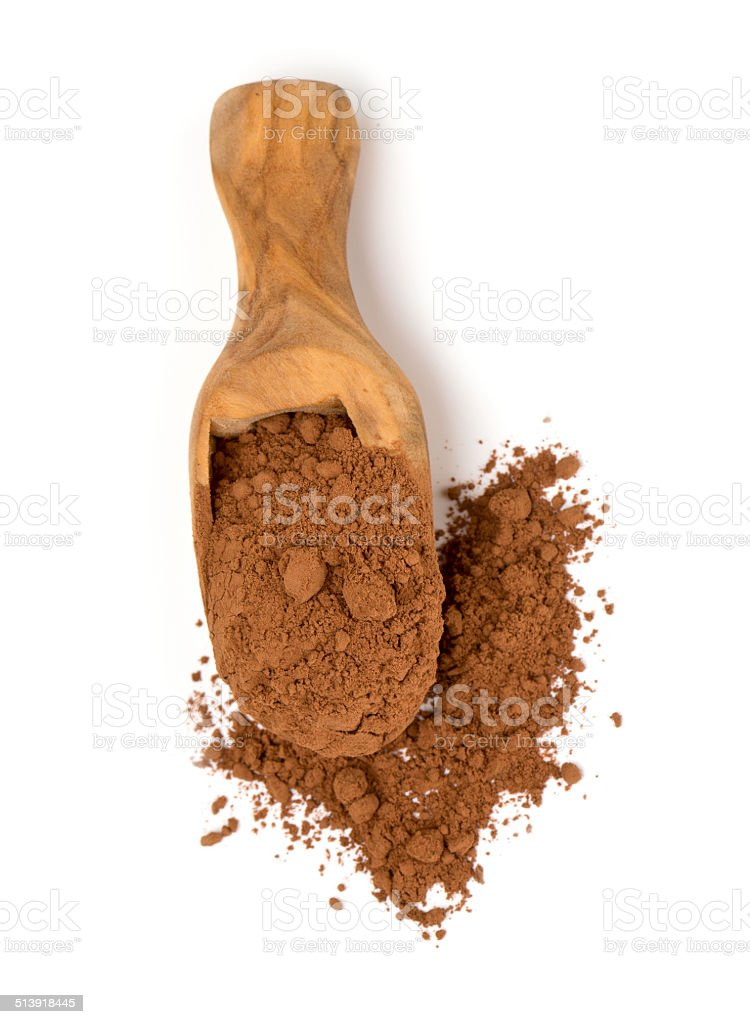 cocoa powder in a scoop isolated on white stock photo