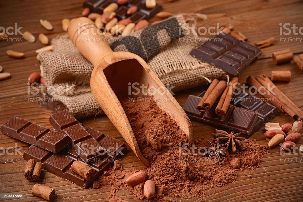cocoa powder in the foreground stock photo
