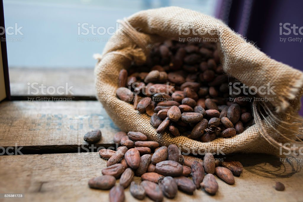 Cocoa sac over the wood stock photo