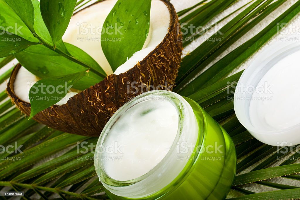 Coconut body care cosmetics in green container and white top stock photo