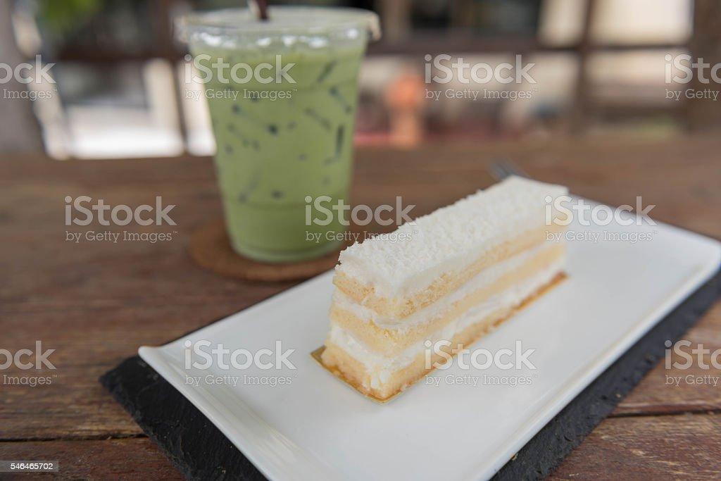 Coconut cake and milk green tea stock photo