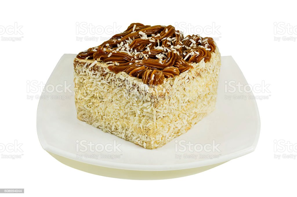 Coconut cake on plate isolated on white stock photo