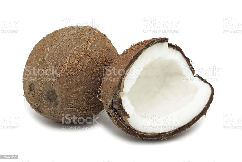 A coconut cracked open and in half stock photo