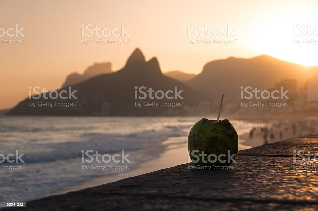 Coconut Drink in Ipanema Beach by Sunset stock photo
