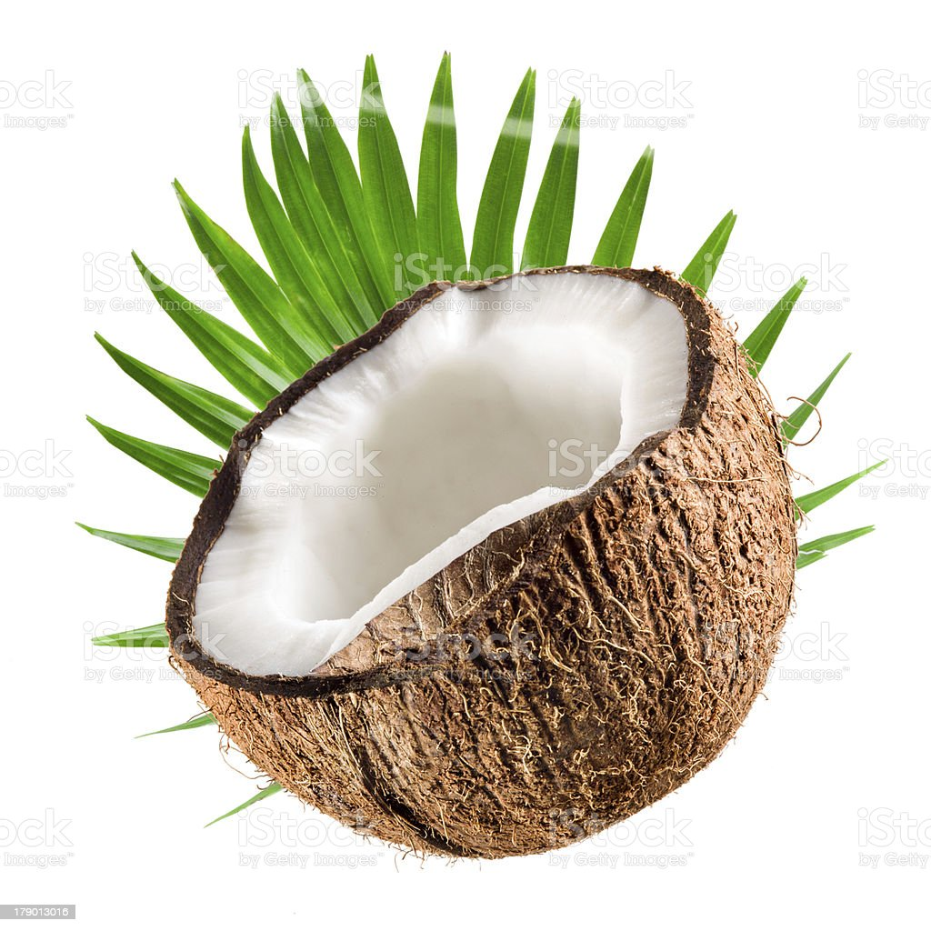 Coconut half with leaf on a white background royalty-free stock photo