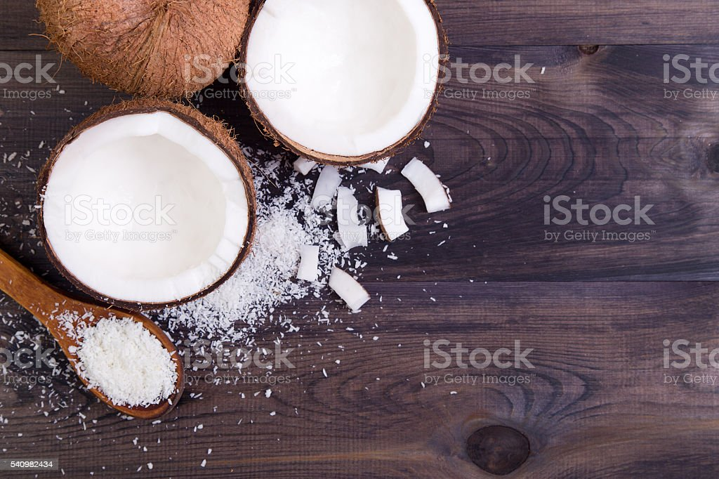 Coconut halves with shell stock photo