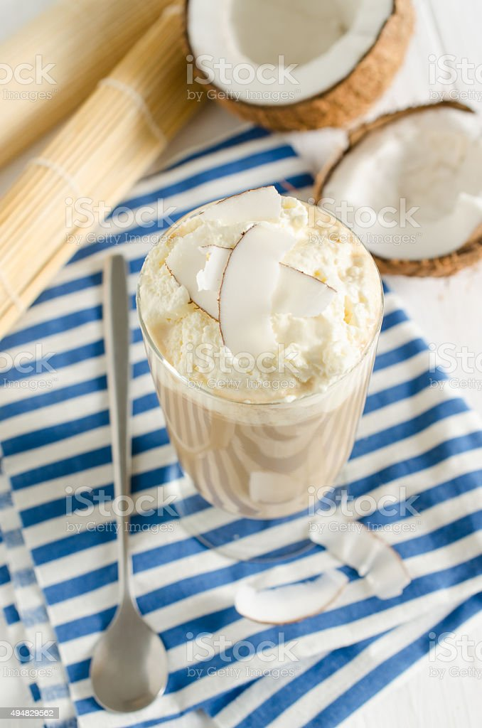 Coconut ice coffe with whipped cream, sprinkled with coconut flakes stock photo