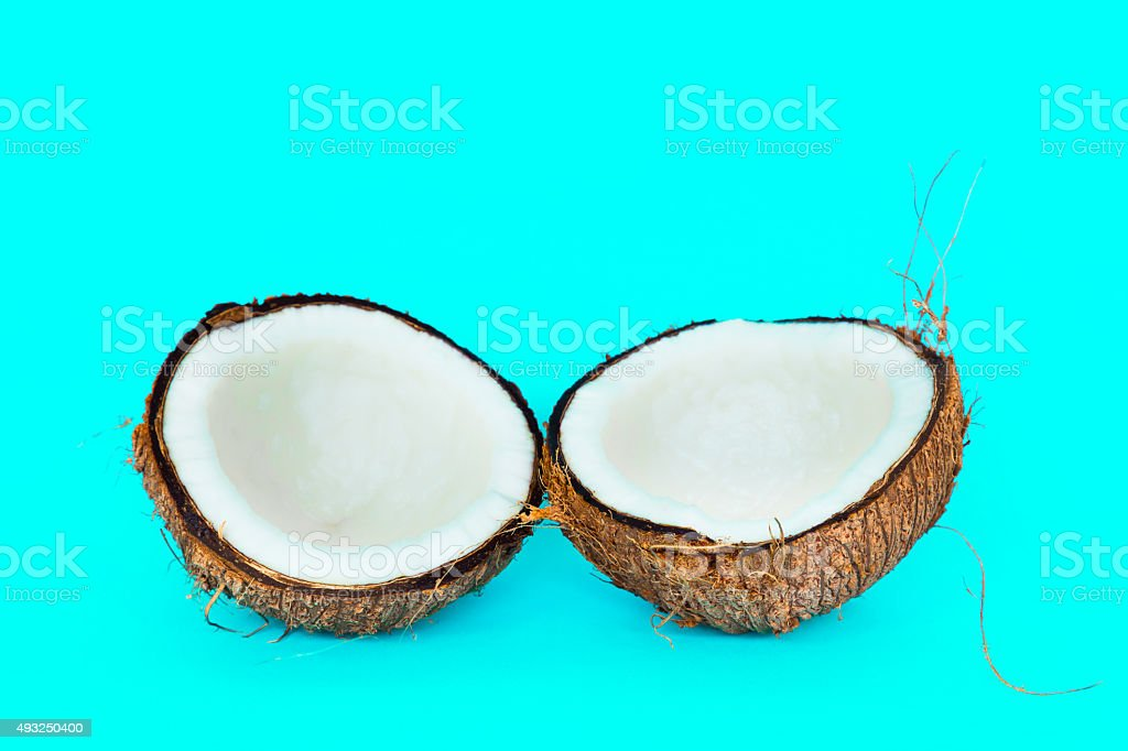 Coconut is split into two parts. stock photo