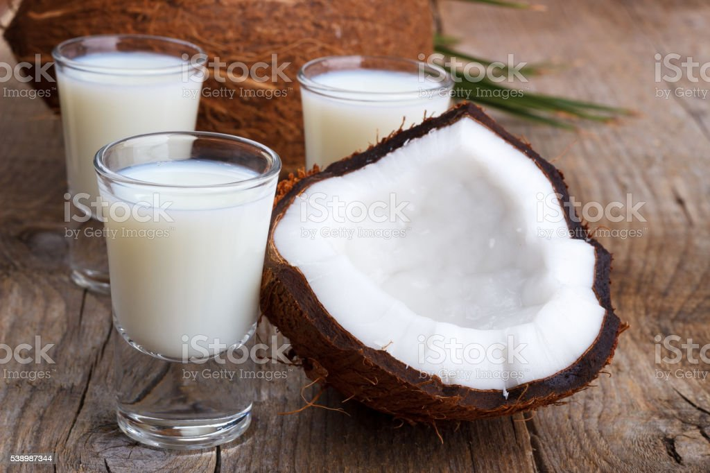 Coconut milk and shells stock photo