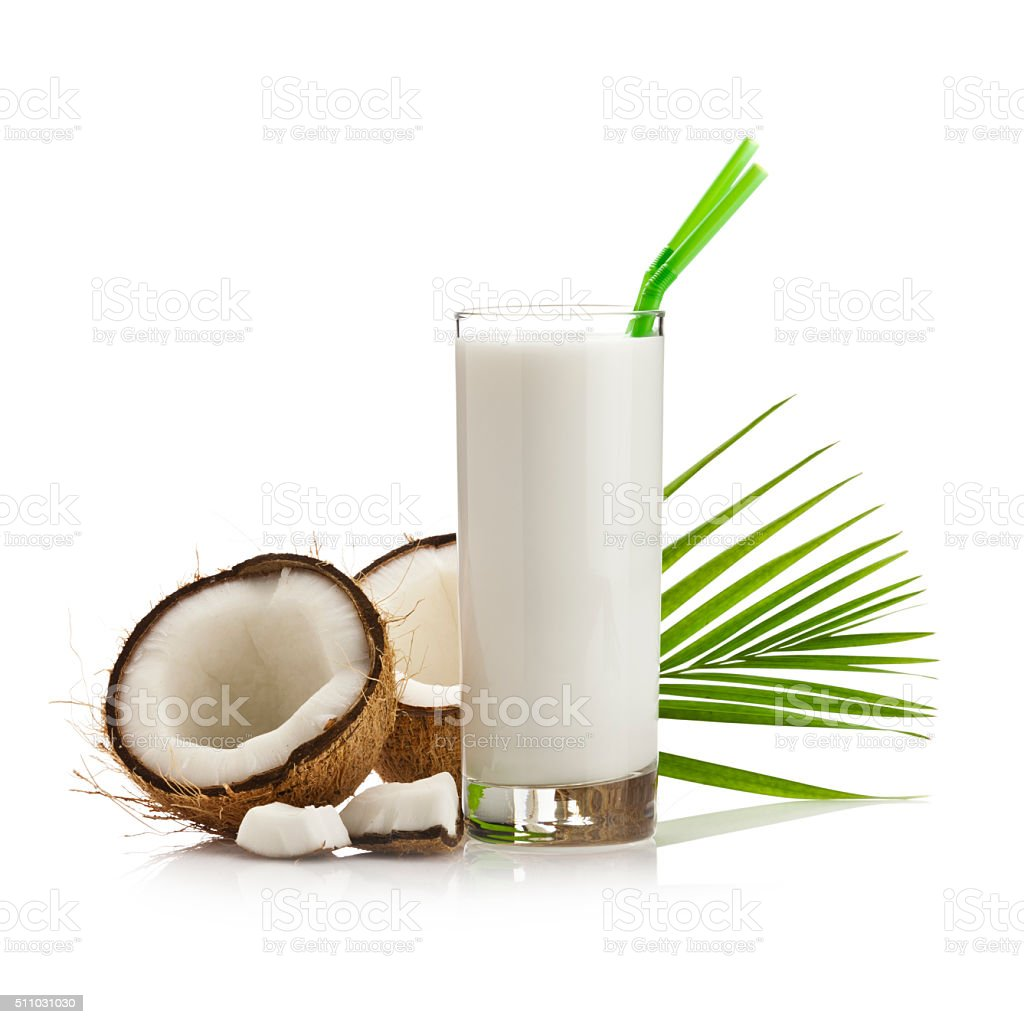 Coconut milk cocktail and coconut halves stock photo