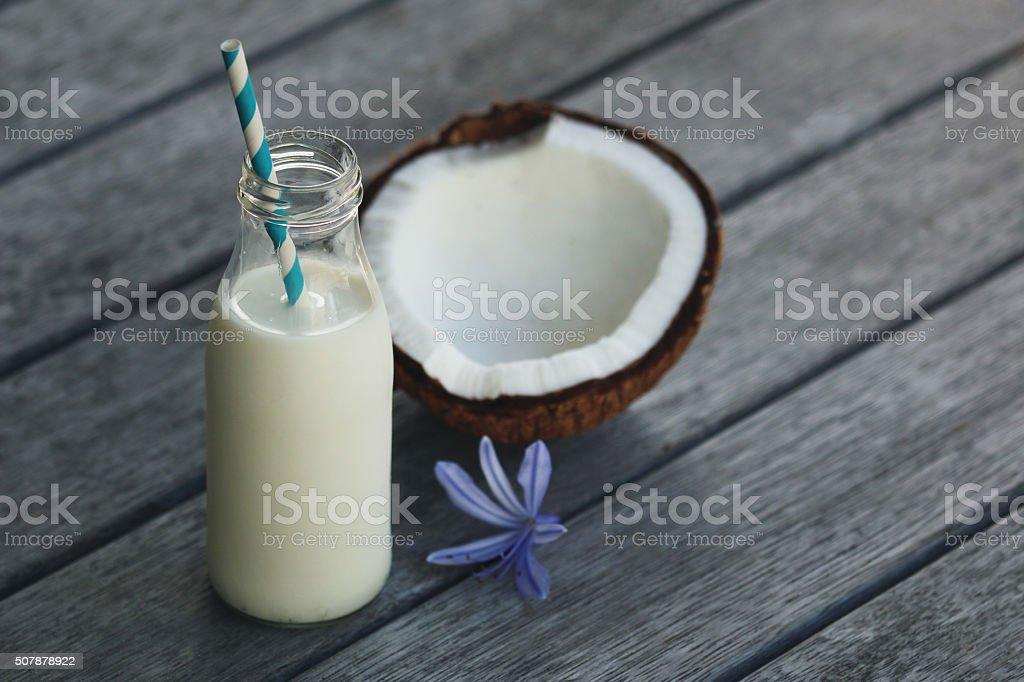 Coconut milk in a bottle stock photo