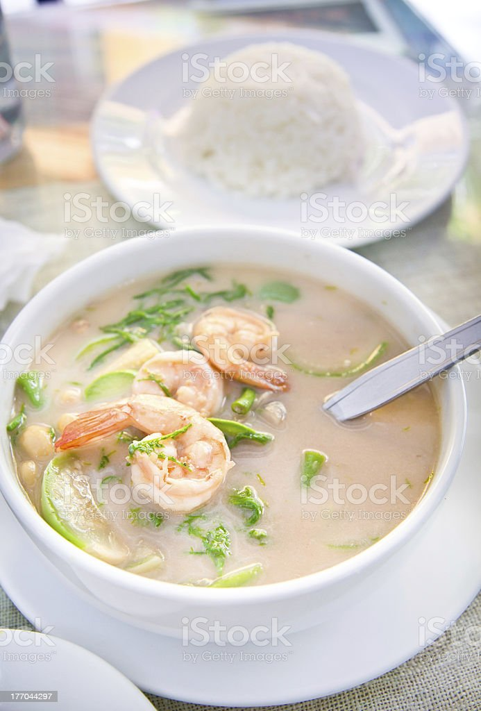 Coconut milk soup with Shrimp , rice and Vetgetables stock photo