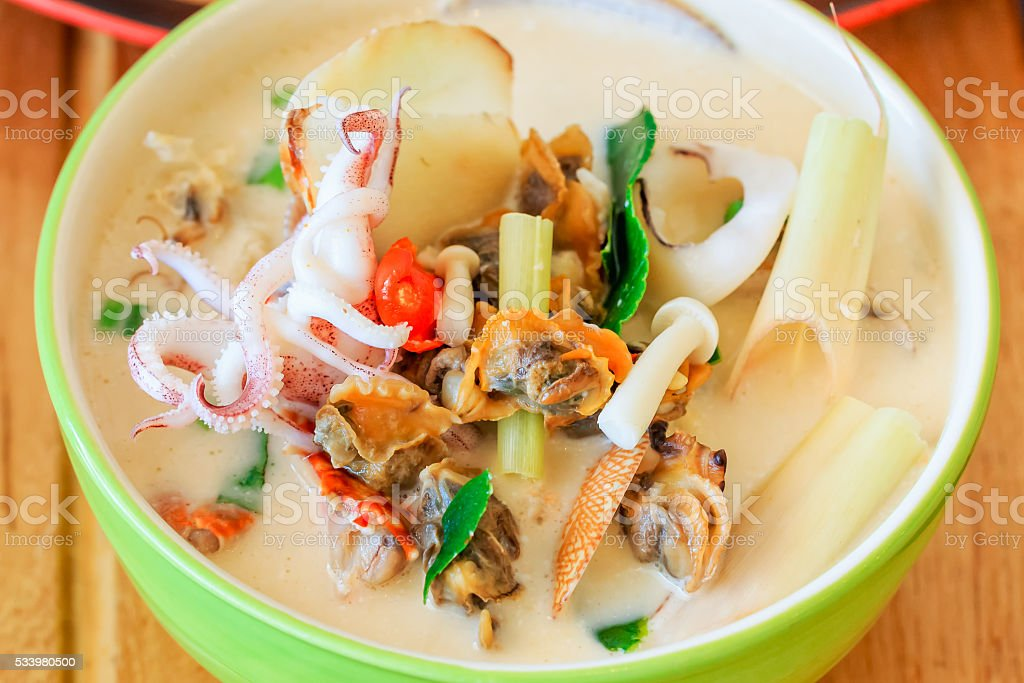 coconut milk spicy soup with seafood, Tom Kha Ta-lay stock photo