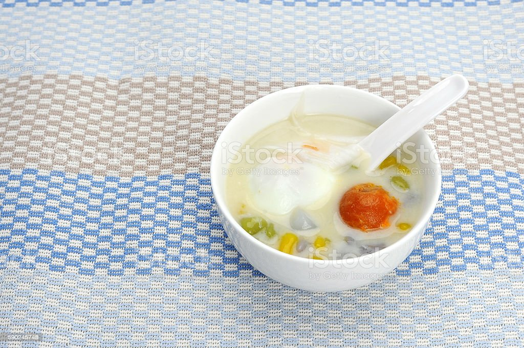 Coconut Milk with Bua Loy in white cup stock photo
