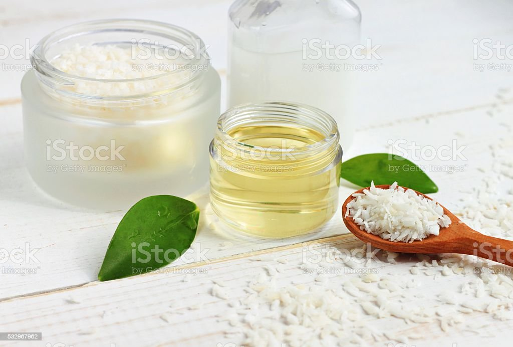 Coconut oil and coconut dried shavings stock photo