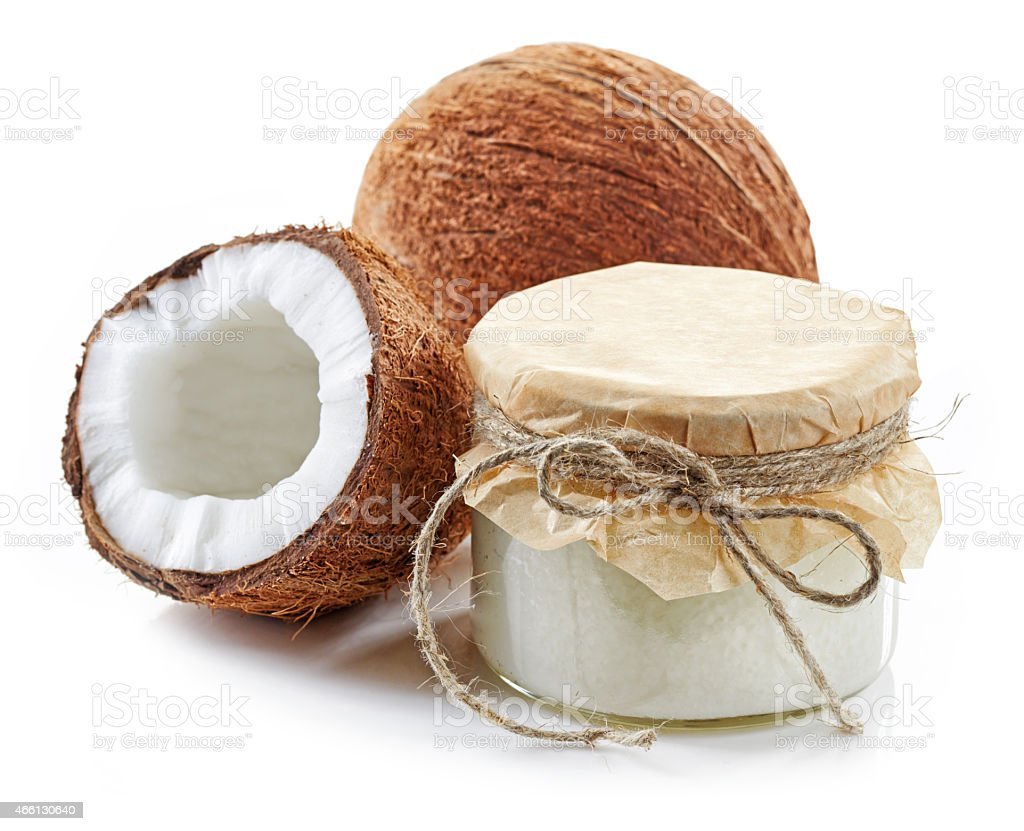 coconut oil and fresh coconuts stock photo