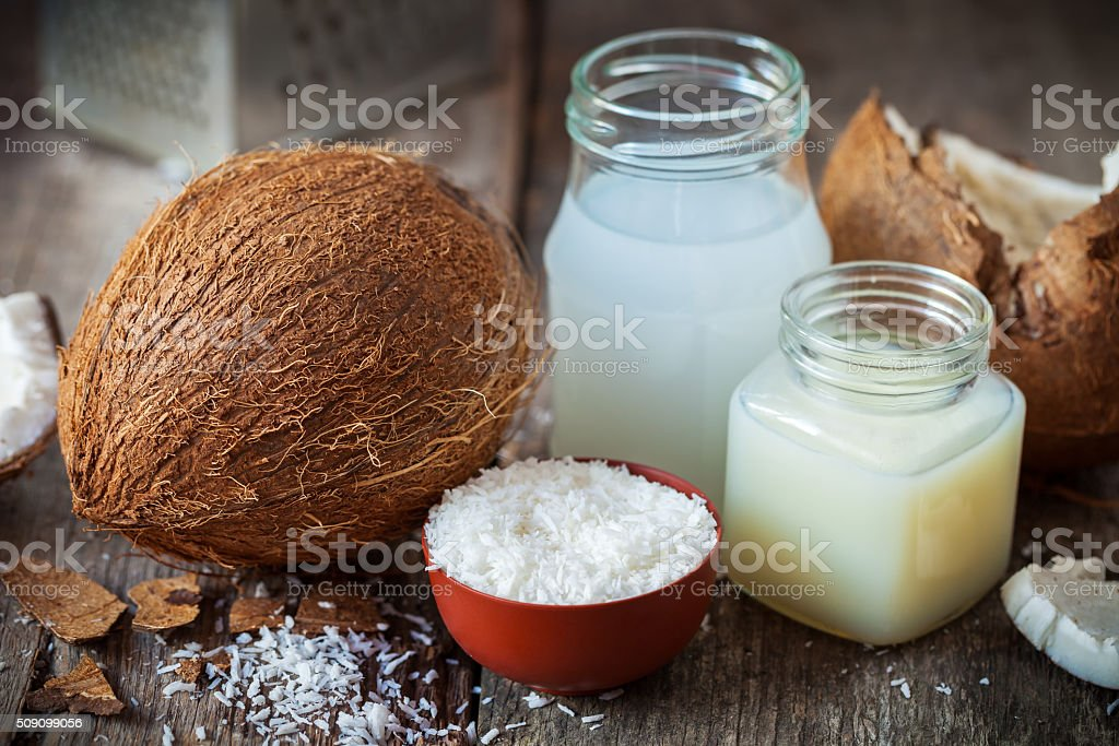 Coconut oil and milk, grounded coconut flakes and  coco nut stock photo