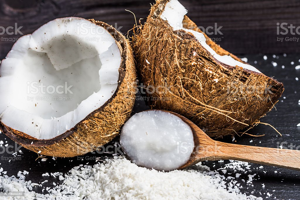 Coconut oil for alternative therapy and cooking stock photo