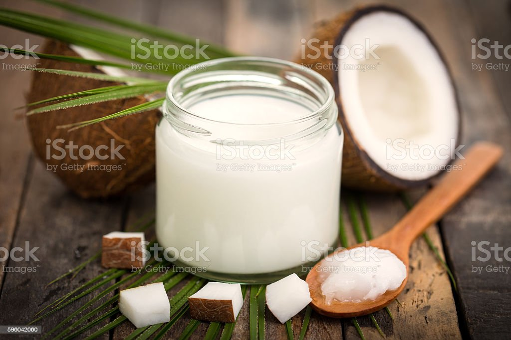 Coconut oil on the wooden table stock photo
