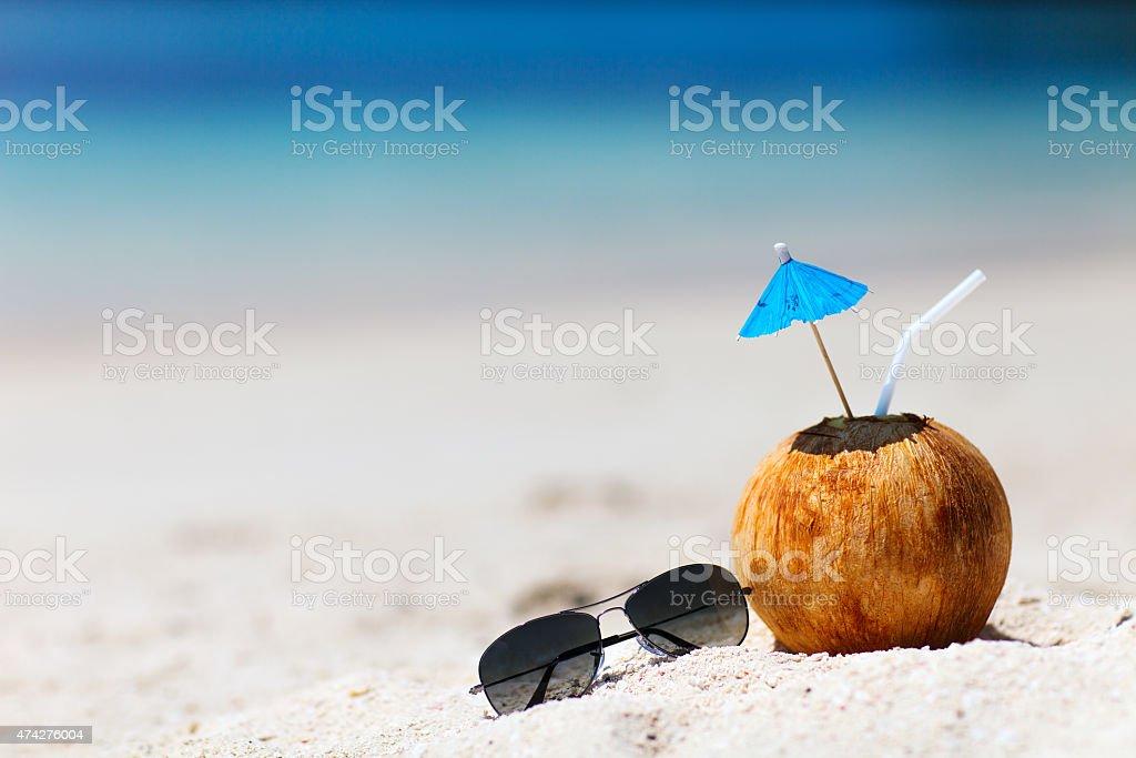 Coconut on a tropical beach stock photo