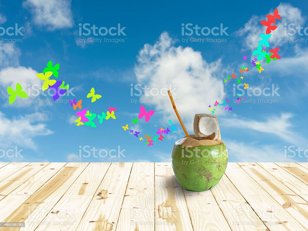 Coconut on table and blue sky in background royalty-free stock photo