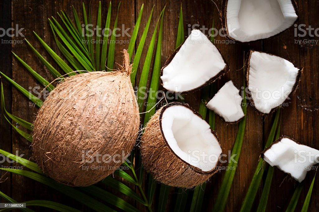 Coconut on wooden table stock photo