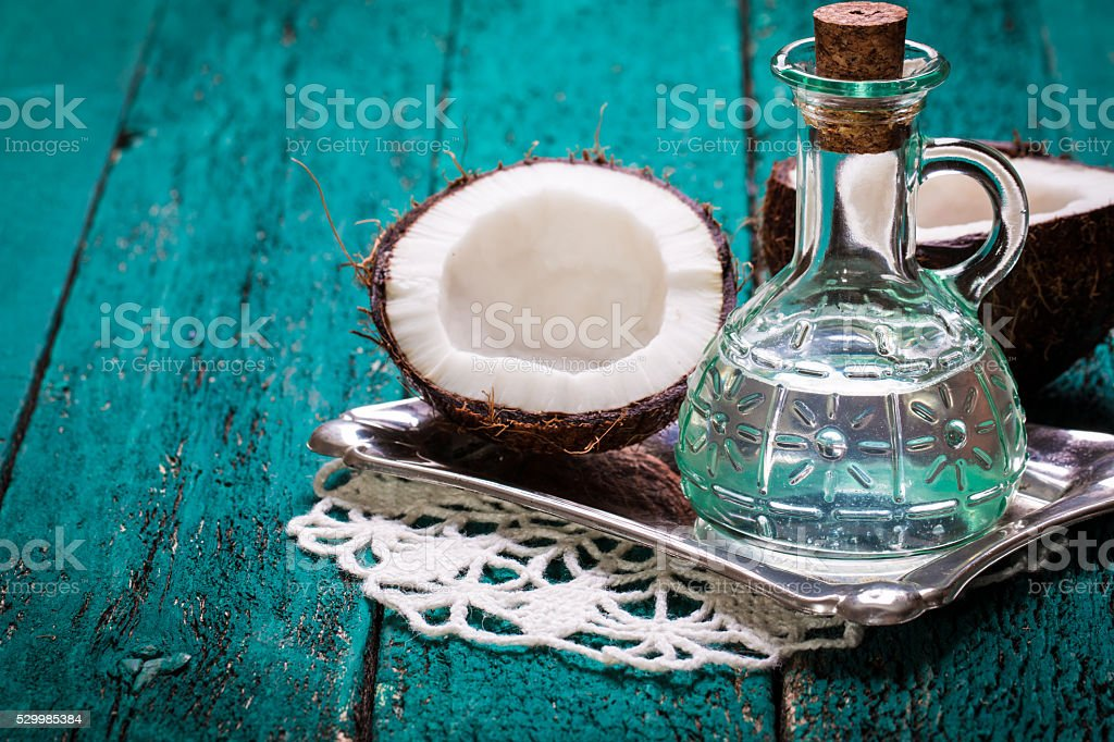 Coconut on wooden table.Organic healthy food concept.Beauty and SPA concept. stock photo