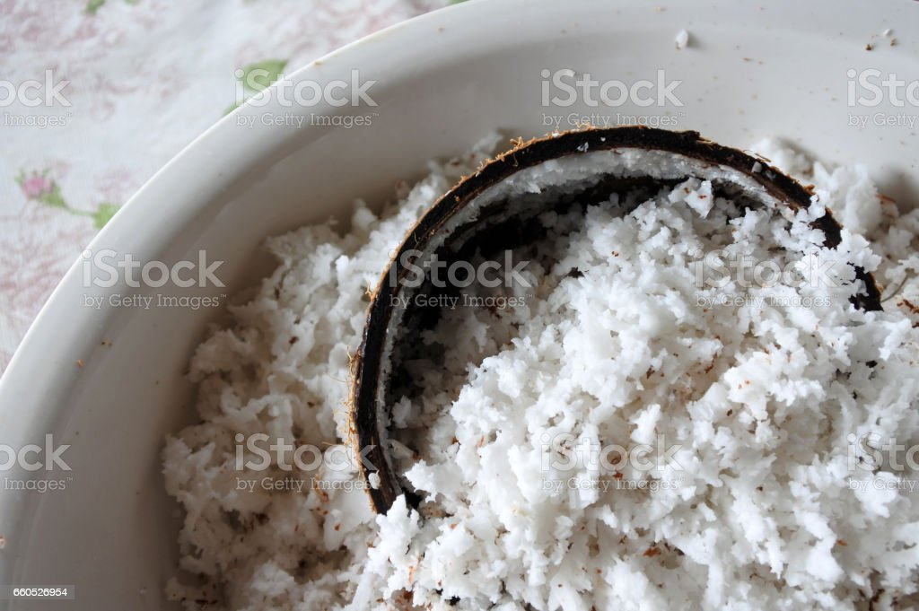 Coconut palm fruit and Coconut flakes stock photo