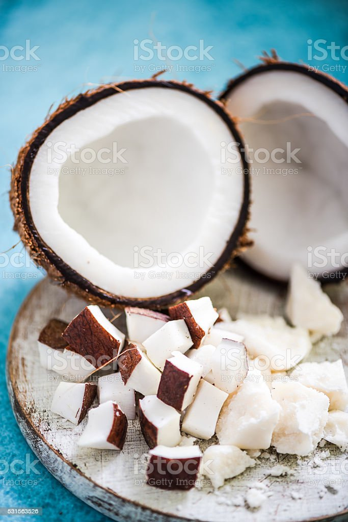 coconut pieces and butter on wooden board stock photo