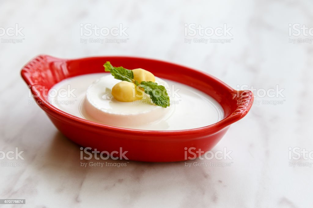 Coconut pudding with milk stock photo