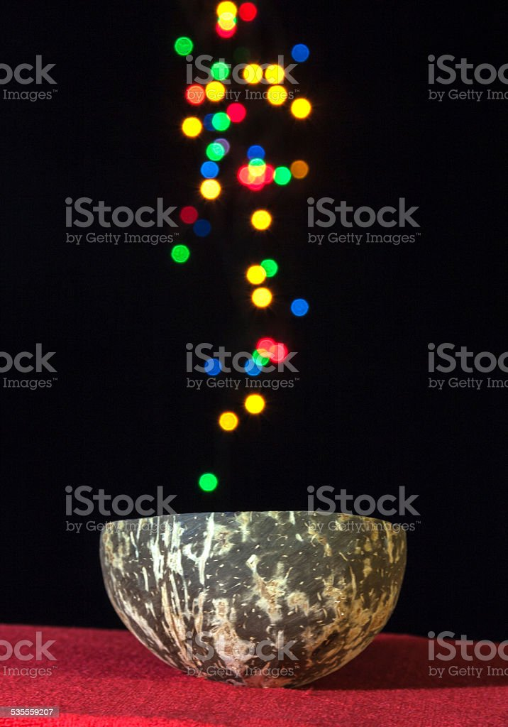 Coconut shell cup with colourful bokeh royalty-free stock photo