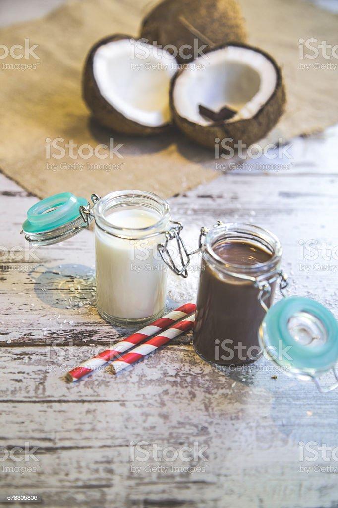 Coconut vegan milk non dairy in different bottles stock photo